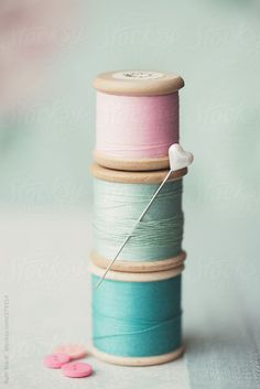 Stack of vintage wooden cotton reels by RuthBlack | Stocksy United