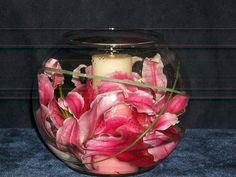 Instead of a votive, filled with water and floating tea lights Fishbowl Centerpiece, Lily Centerpieces, Wedding Centerpieces, Wedding Decorations, Stargazer Lily Wedding, Stargazer Lilies, Someday Over The Rainbow, Prom Themes, Some Beautiful Pictures