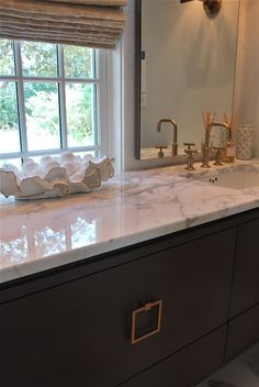 The Ultimate Beach House Home Tour, fixtures aged brass vanity millwork