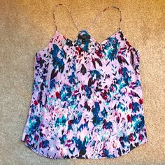 NWT J.Crew Petite Carrie Cami in Watercolor Floral Brand new! I wish this item fit, but I am tall and accidentally ordered a 4 petite. Colors are gorgeous and it's a flowy fit, made of 100% silk. Please ask if you have questions! No trades. J. Crew Tops Tank Tops