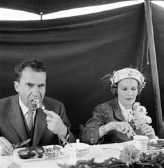 Richard and Pat Nixon, eating at unknown event, circa late 1950s-early 1960s