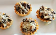 Mini Mushroom Tartlets - I use Safeway frozen mini tartlets and pass on the wine. I've made a similar recipe of my own for years! Appetizer Salads, Holiday Appetizers, Yummy Appetizers, Appetizer Recipes, Holiday Recipes, Mushroom Appetizers, Tart Recipes, Cooking Recipes, Gastronomia