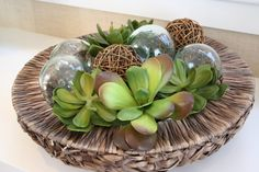 creative succulents with glass balls and woven balls in a textured basket...Nice contrast