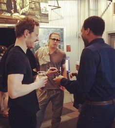 | TELLURIDE | Michael Fassbender, Brad Pitt, and Chiwetel Ejiofor chatting after a screening of 12 YEARS A SLAVE -- oh to be a fly on that wall...