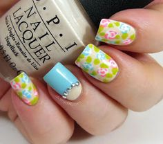 Floral manicure with turquoise accent nail