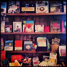 Our bookshelves are full of fun new titles! (i.e.-Little Paris Kitchen, Candy Bars, Tart Love, FELT, Party Origami) #books #pantone #shopping