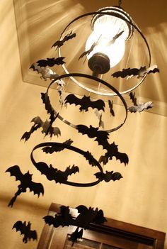 Spooky Bat Chandelier using embroidery hoops and foam bats.