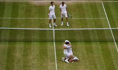 Nicolas Mahut and Pierre-Hugues Herbert celebrate victory at Wimbledon