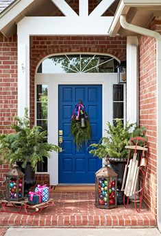 You don't have to limit your outdoor Christmas decorations to traditional red and green. Unexpected hues like fuchsia, teal, purple, and royal blue can lend an equally festive air to your front porch. Best Outdoor Christmas Decorations, Christmas Greenery, Christmas Porch, Christmas Lights, Teal Christmas, Minimal Christmas, Natural Christmas, Primitive Christmas, Holiday Lights