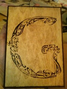 Wood burning OR Dremel and stain!