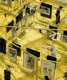 OTTOTTO's prismatic pavilion suspends terry o' neill photos in a maze of rebar