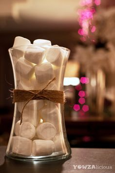 REPURPOSED Christmas Decorations ::    Here, I used a glass vase (that I kept after receiving V-Day flowers many years ago)...and twine (that I kept after receiving a gift-wrapped package many Christmases ago). The only thing I had to buy was the marshmallows (which I found at the Dollar Store).    TOTAL COST = $1