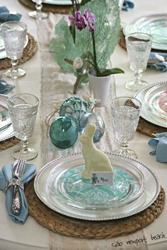 coastal  accessories and shades of turquoise. I love how the white chocolate bunnies look at the table.