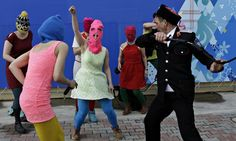 Members of the punk group Pussy Riot, including Nadezhda Tolokonnikova in the blue balaclava and Maria Alekhina in the pink balaclava, are attacked by Cossack militia in Sochi, Russia. Photograph: Morry Gash/AP
