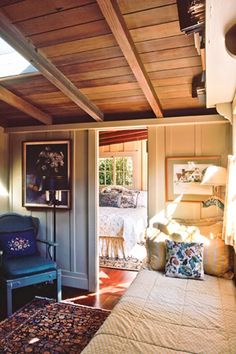 RUSTIC GARAGE APT>Board and batten paneling and wood ceiling add architectural interest and rustic appeal to this room. Old Cottage, Cottage Living, Cosy Living, Living Room Panelling, Cottage Kitchens, Board And Batten, Wood Ceilings, Bedroom Vintage, Big Houses