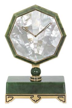 A NEPHRITE AND MOTHER-OF PEARL DESK MYSTERY CLOCK, BY CARTIER