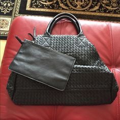 BOTTEGA VENETA INSPIRED BLACK TOTE BOTTEGA VENETA INSPIRED BLACK TOTE. Includes attached zippered bag. Never worn but has crease on one side from being folded in the closet. Bags