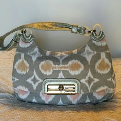 Coach purse Ikat Coach purse perfect color for Spring and Summer. Front latch closure small inside pocket then large main pocket. Inside large pocket small zipper pocket and 2 slip pockets. There are some small pen stains as shown in photo on inside small pocket otherwise in great condition! Re Poshing as I have too many purses and haven't used this. Coach Bags Shoulder Bags