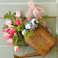 I like the watering can idea...maybe with a different choice of flowers.