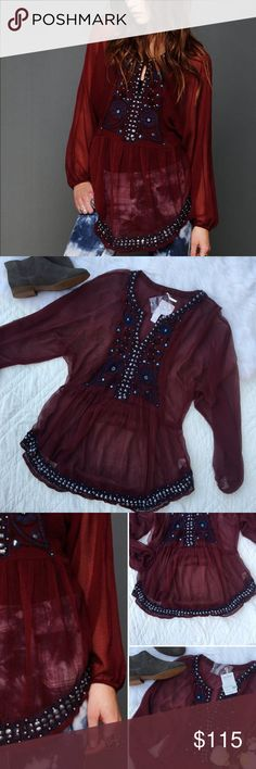 •Free People Maroon Indie Goddess Tunic• Free People Indie Goddess Tunic in Maroon. This is the perfect bohemian piece. The material is super light weight and sheer.   •size: medium •color: maroon embellished tunic •bohemian tunic •front hook closure to create a keyhole •new with tags •one flaw with a sequin missing, (refer to photo 4) extra sequins come with the top to replace.  •100% polyester   Approx Measurements (laying flat):     •length(shoulder to hem): 28in  •No trades(comments will…