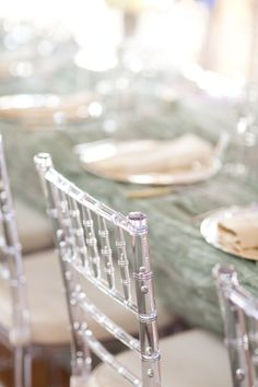 Tablescape - love the clear chairs against the gold and blue tones.