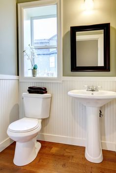 Minimalist basic powder room with wainscoting