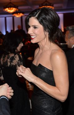 Sandra Bullock flashed a big grin at the Directors Guild Awards.