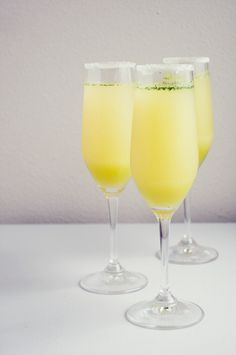 Limencello Champagne Cocktail 1/4 cup mint leaves, 1/4 cup limoncello, 2 tablespoons granulated sugar plus additional for dipping Champagne flutes, Lemon peel strips from 1 lemon, 4 teaspoons fresh lemon juice plus 1 lemon wedge, About 1 cup chilled Delamotte Champagne, or Cono Sur Brut sparkling wine