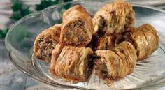 Saragli / Greek Christmas Phyllo Rolls With Pistachios And Walnuts Recipe (Amateur Cook Professional Eater) Greek Sweets, Greek Desserts, Greek Recipes, No Bake Desserts, Pastry Recipes, Cooking Recipes, Greek Christmas, Walnut Recipes, Sweets Cake