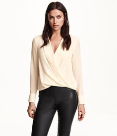 Wrap-front blouse in airy, woven mulberry silk fabric. Collar and lapels, buttons, and hook-and-eye fastener at front. Slightly wider cuffs with buttons. | H&M Modern Classics