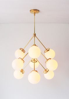 Modern Brass Chandelier 9 White Glass Globes Statement