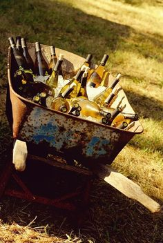 If you're the type that likes to impress with your unconventional choices and contrasts, then maybe you'll like this idea for a wedding bar. Keep your champagne bottles in a rusty cart filled with ice.