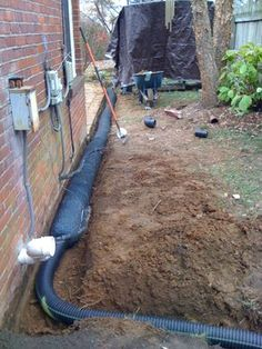 french drain system around outside of houseburrying downspout to gutterDo I Need to Waterproof My Basement? Backyard Drainage, Landscape Drainage, Backyard Landscaping, Drain Français, French Drain Installation, Foundation Drainage, French Drain System, Drainage Solutions, Drainage Ideas