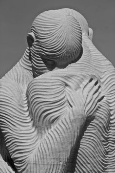 """For some reason, this reminds me of underlying sinew and muscle structures. Slightly morbid of me, but also suggests that affection is more than skin deep.""~Sethaka. Photographs from the National Sculpting Festival at Revere Beach in Boston. From the post, ""Who Could Have Imagined?"" posted to the blog ""Wrong Side of the Camera"" on July 22nd, 2013."