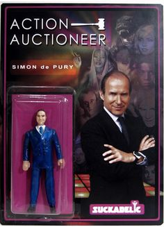 """ACTION AUCTIONEER  PRICE: $125  MATERIAL: Resin  SIZE: 3.75"""" figure in 6"""" X 9"""" blister card   QUANTITY MADE: 50   The World's best, most famous Art Auctioneer, Simon DePury, now as a Suckadelic Bootleg Figure."""