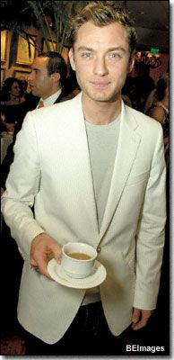 Jude Law with a cup of tea and a dashing suit*