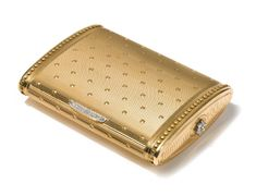 A FRENCH GOLD AND DIAMOND CIGARETTE CASE, CARTIER, PARIS, MID 20TH CENTURY
