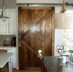 Sliding Barn Door is SO beautiful. Perhaps between master bedroom and en suite.