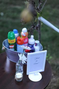 """""""just in case""""  for an outdoor reception have a """"just in case"""" bucket filled with lotion, hand sanitizer, bug spray, sunblock, tylenol etc."""