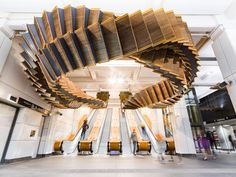80-Year-Old Wooden Escalators are Repurposed as a Sculptural Ribbon by Artist Chris Fox   Colossal