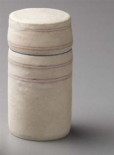 Lidded box, Porcelain, matte white glaze with four pairs of delicate pink inlaid lines, the interior of the lip matt blue crossed with diagonal sgraffito lines. 5 in. (12.7 cm) high, c.1974