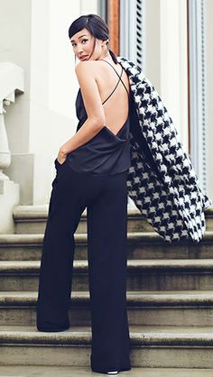 Nicole Warne of Gary Pepper wearing a barely-there camisole and office-worthy black trousers