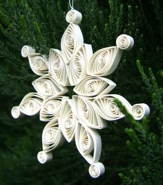 Quilled paper snowflake...I want one for Christmas time @Kayla Carpenter