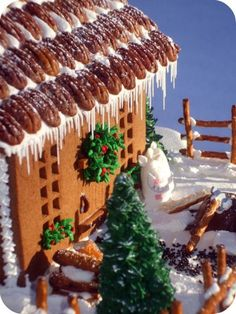 Nuts for roofing tiles, pretzels as fences gingerbread house christmas holiday Gingerbread House Designs, Gingerbread House Parties, Gingerbread Village, Christmas Gingerbread House, Christmas Sweets, Christmas Goodies, Gingerbread Man, Christmas Baking, Christmas Holidays