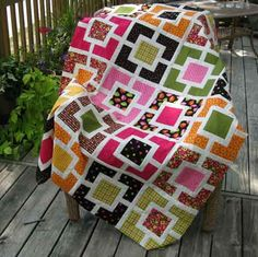Gardenfence - love the brights and white sashings. Must add this one to my To-Do-Next quilt list!