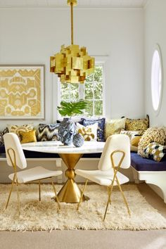 How to be the perfect dinner party host: Your dining chairs don't all need to match. Booth seating creates great flexibility when hosting large or small groups and these Jonathan Adler Maxime Dining Chairs($1,995)create a great statement in this breakfast nook come dining room.