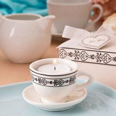 Find Tea time cream colored ceramic tea cup & saucer tea light candle holder with quantity discounts here, along with other wedding favors and shower gifts. Tea Party Favors, Candle Wedding Favors, Candle Favors, Tealight Candle Holders, Birthday Favors, Tea Light Candles, Tea Lights, Tea Cup Saucer, Tea Cups