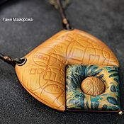 large, inflated pendant made of polymer clay . Handmade.