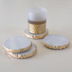 Protecting your precious furniture doesn't have to mean sacrificing style! These beautiful coasters are made from natural white marble and are given a subtle dose of glamour with a touch of gold on their edges.   As marble is a natural material, variations in appearance are inevitable. Take care, as marble can be susceptible to staining.