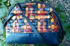 $55.00 USD | LadysPurse | Vintage | Small leather basket-woven shoulder bag by Gió, in rainbow jewel tones.  Made in Italy.  Size and shape make it perfect for large-busted women by tucking out of the way under an arm, and suede-sided straps make it a good choice for ladies with sloped shoulders.